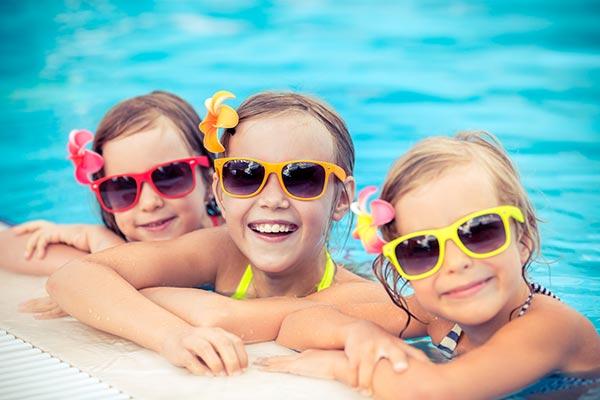 Children's Eczema Care –Happy girls in swimming pool
